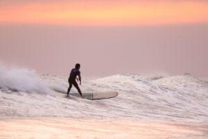 longboard surfing in Oregon Coast Communities